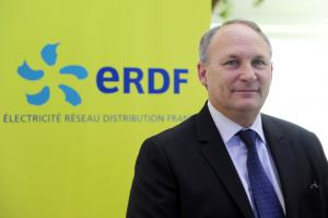 President of ERDF (Electricity Network Distribution France) Philippe Monloubou poses near the new 'smart' electric meter during the opening of the showroom of ERDF, on May 20, 2014 in Paris. AFP PHOTO / DOMINIQUE FAGET (Photo credit should read DOMINIQUE FAGET/AFP/Getty Images)