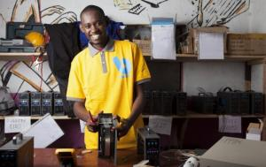 """Joseph repairing Smart Solar products at the Bboxx Hub in Musanze, Rwanda"" (Source : Bboxx)"